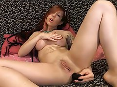 Redhead British babe Faye Rampton masturbates with a dildo